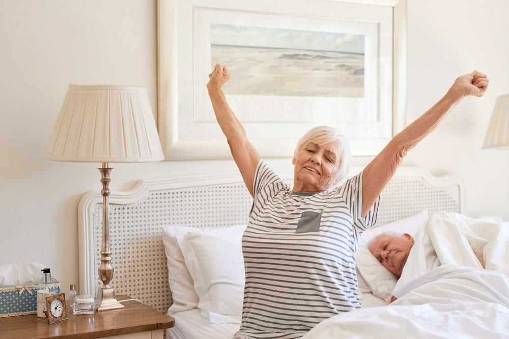 a senior woman waking up