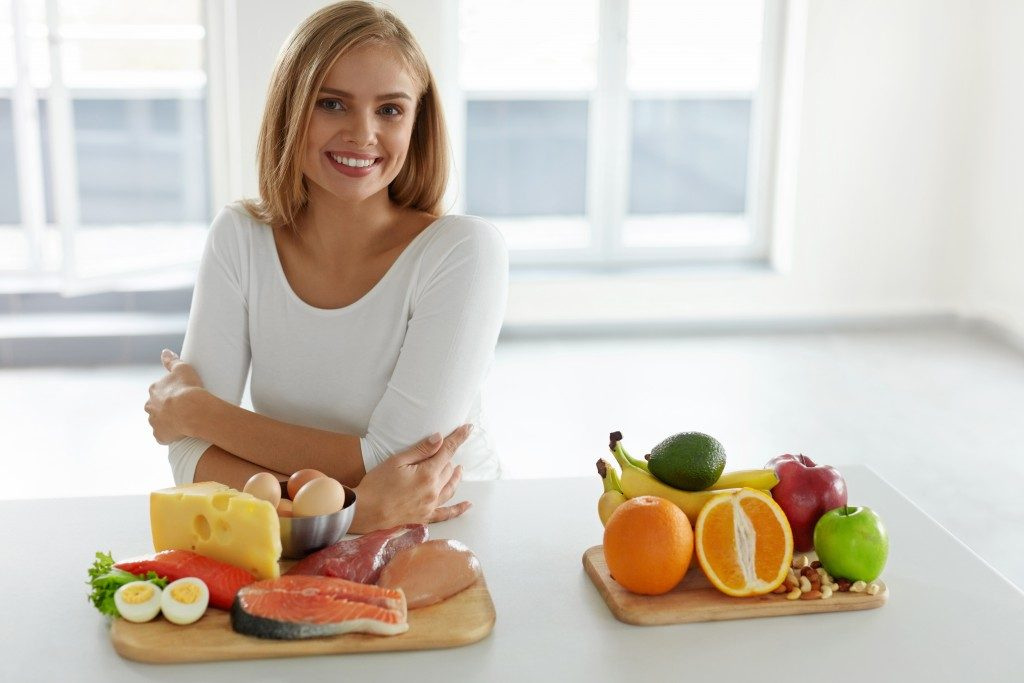 Woman with food nutrition and diet