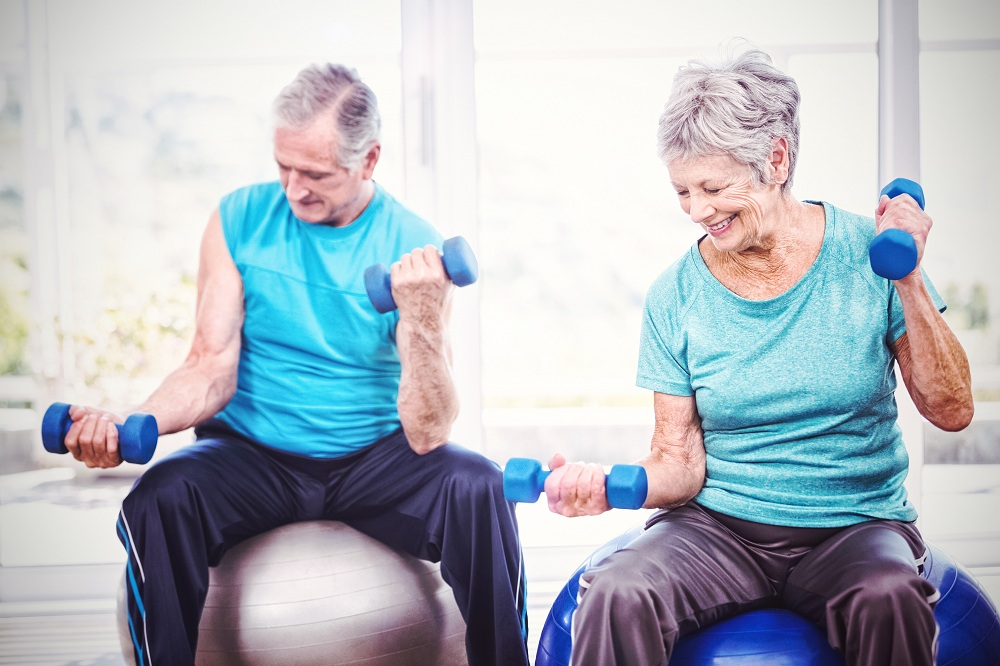 a senior couple working out