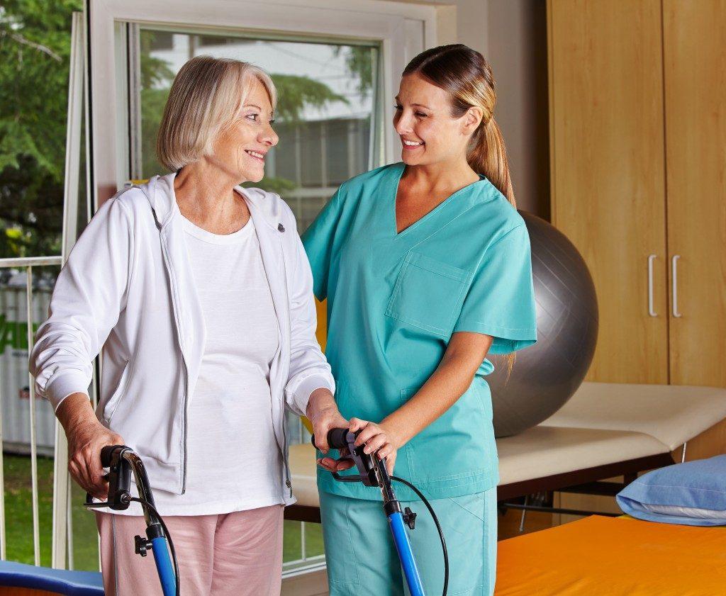 a senior woman and a nurse