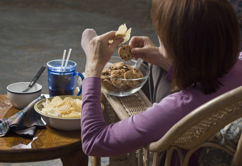 woman eating junkfood
