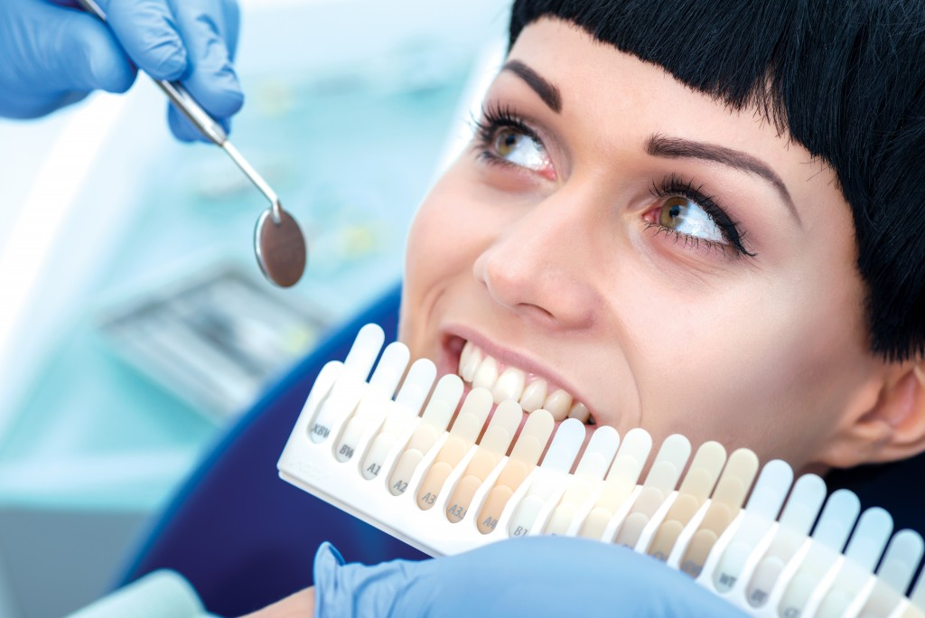 dentist comparin the whiteness of teeth
