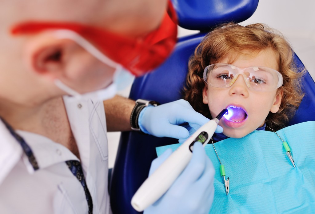 Dentist checking for cavities
