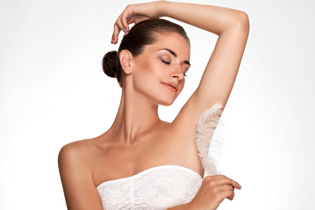 Woman with feather on her underarm