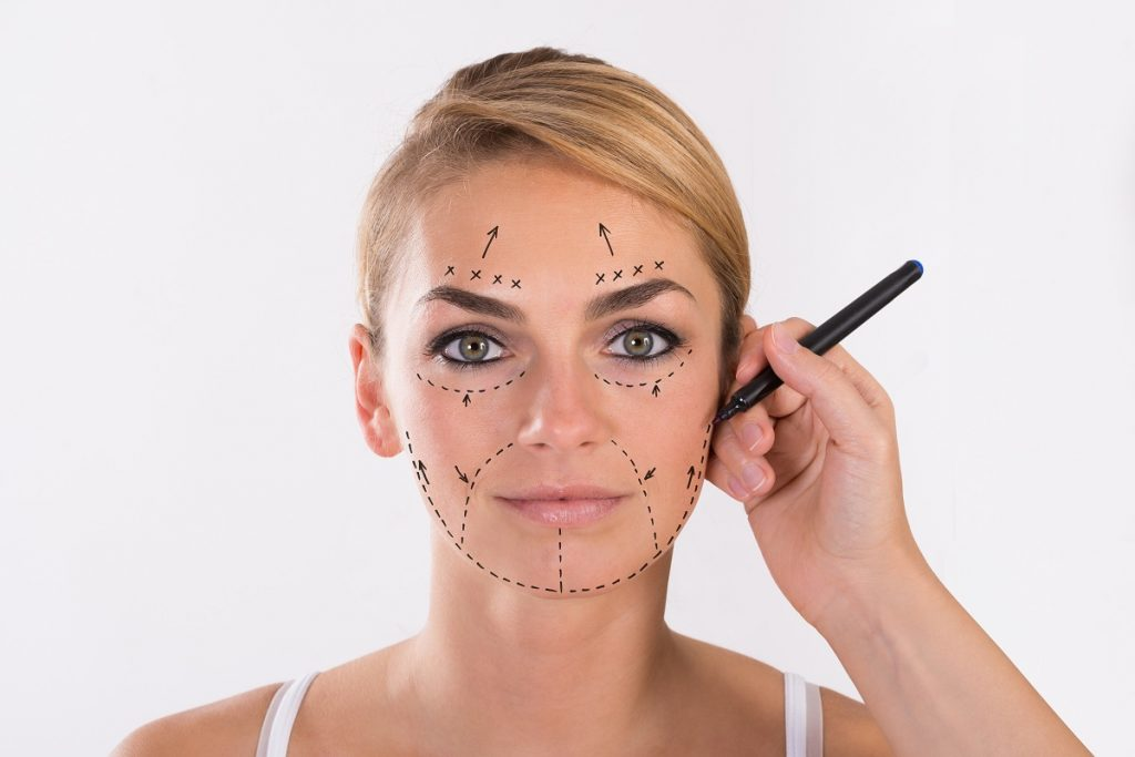 Woman with markings on her face