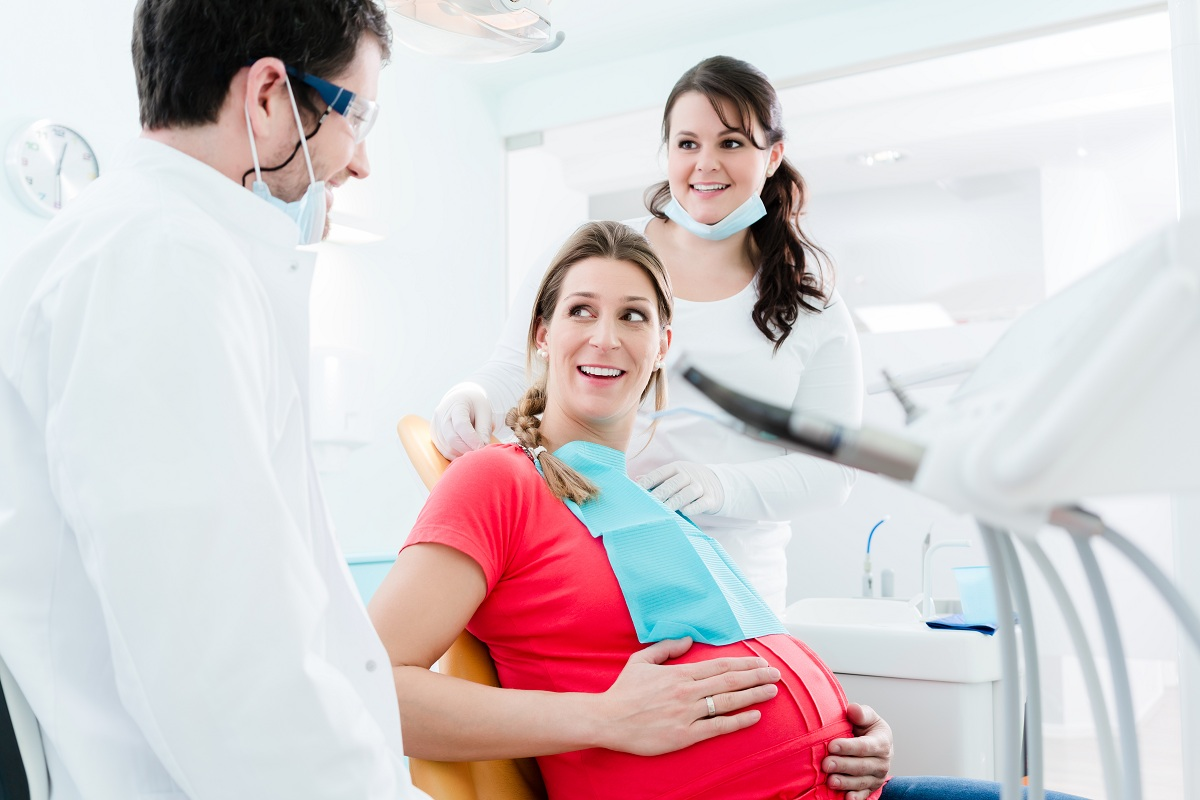 Pregnant patient with her dentist