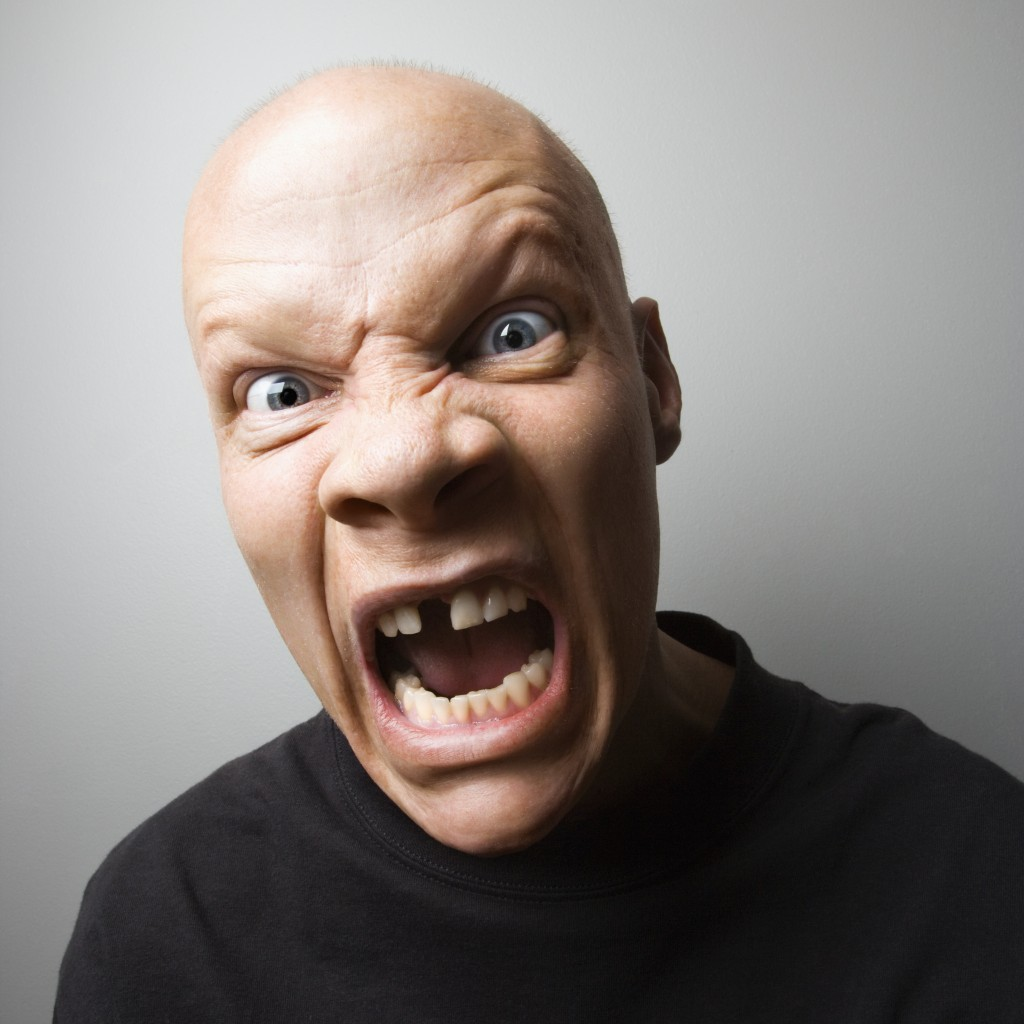 angry man with missing teeth