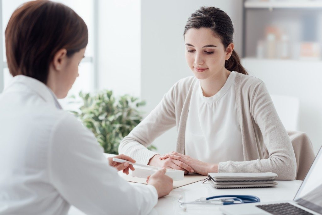 Women consulting doctor