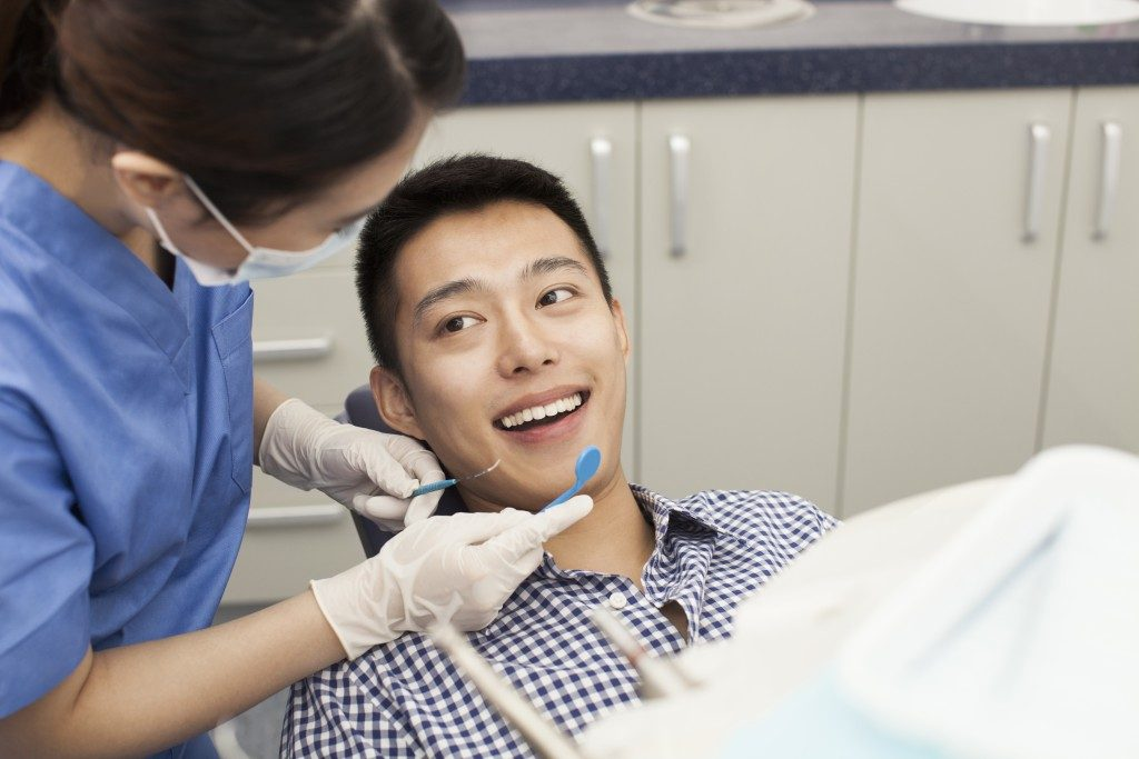 Man with his dentist for a dental appointment