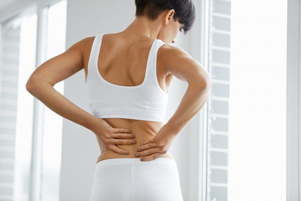 woman having back pains