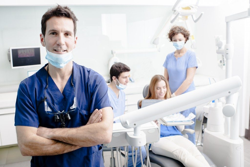 Dentist with his team and patient