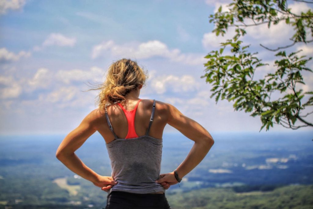 woman looking at view after exercising