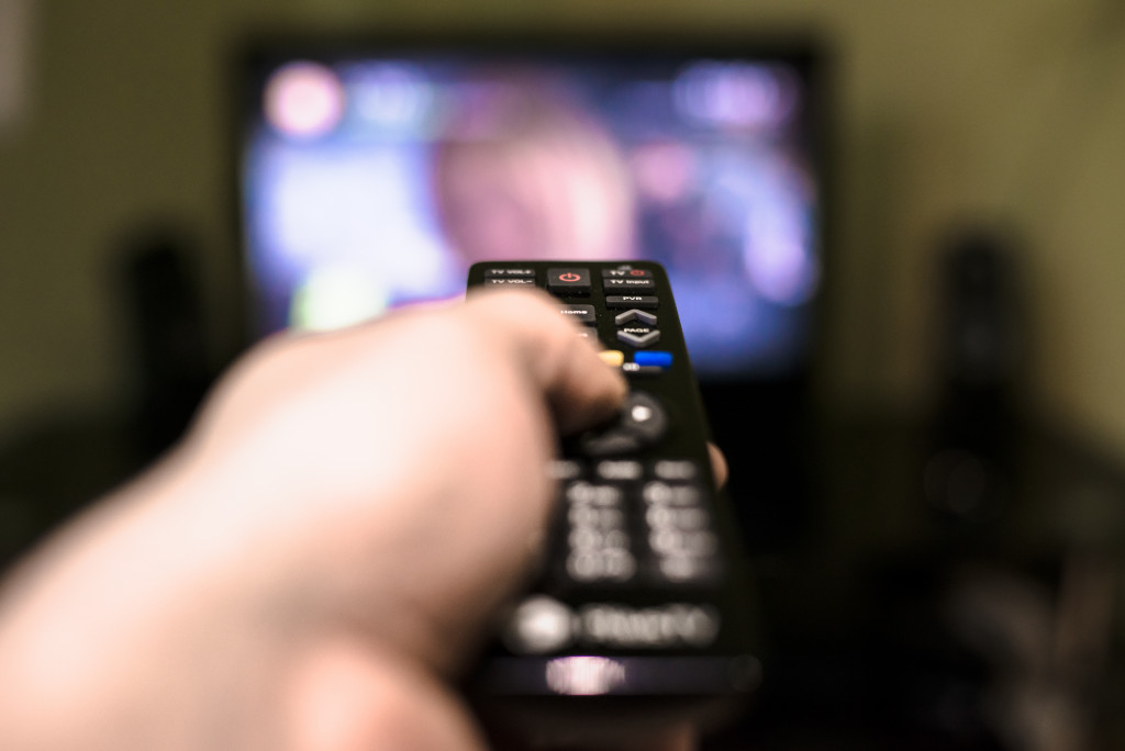 people holding a remote